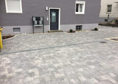 Neu- und Umgestaltung von Hofeinfahrten (Natursteinpflaster)